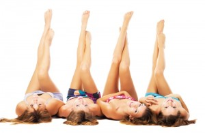 4 girls with their legs raised